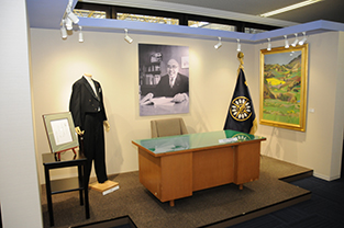 Display featuring the founder's desk and uniform
