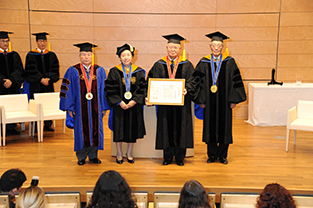 Mr. Yonekura with his honorary doctorate (second from the right)