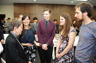 Dr. Daley speaks with study abroad students at the reception